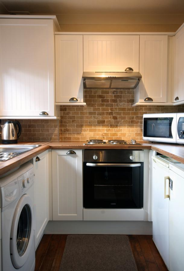 кухня в хрущевке с фартуком из кирпича