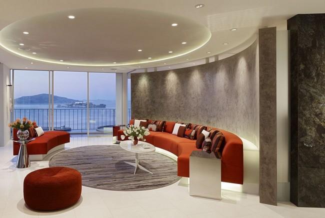 Интерьер трехкомнатной квартиры - гостиная с полукруглой стеной