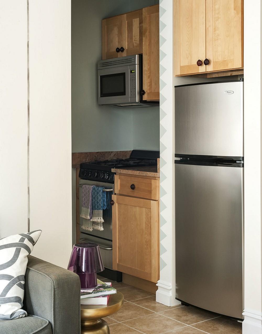 Интерьер квартиры-студии - зона кухни