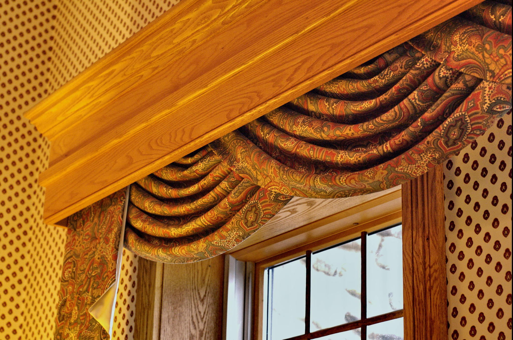 window treatment with swag curtain and cornice